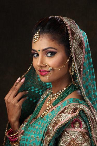 woman-wearing-green-brown-and-pink-sari-