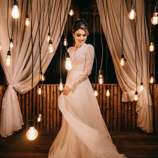 woman-standing-beside-hanging-light-bulb