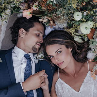 man-and-woman-lying-on-a-bed-of-flowers-