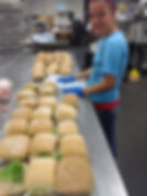 Alicia Dossey prepares sandwiches for a