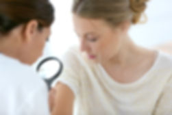 Young woman seeing doctor for dermatolog