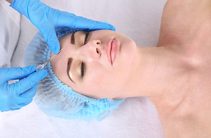 Woman in beauty clinic getting botox inj