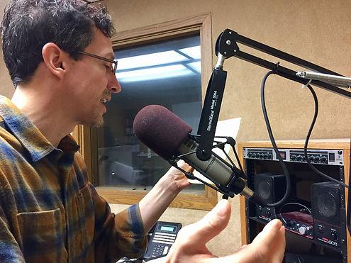 Author Mark Ristau at AM 950 Radio in Eden Prairie, Minnesota, promoting A Hero Dreams, A Novel