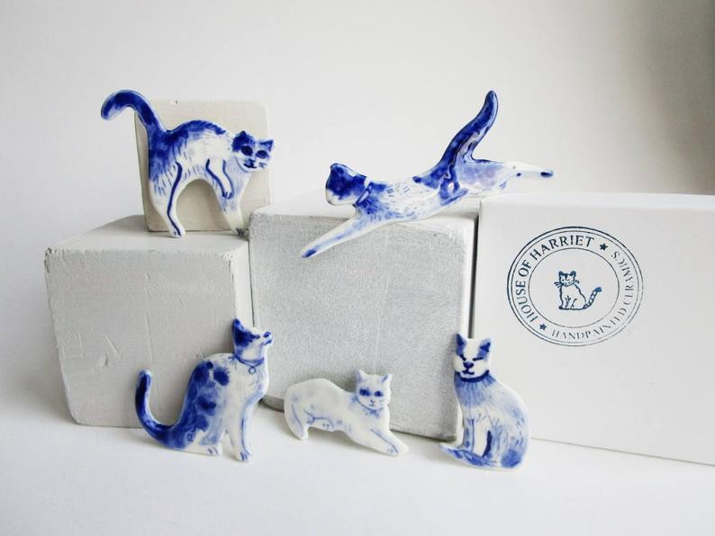 ceramic cat brooches by Harriet Damave