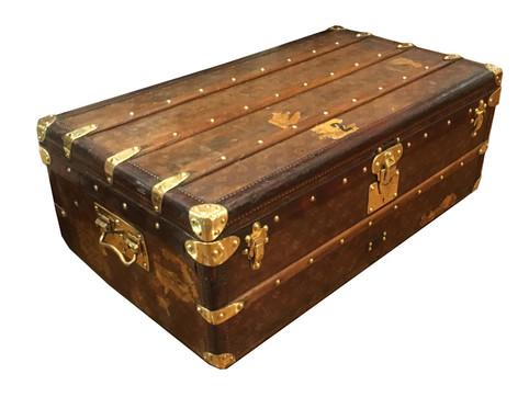 A Louis Vuitton footlocker trunk