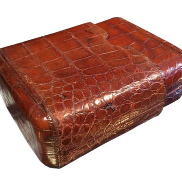 A large crocodile skin travelling cigar wallet