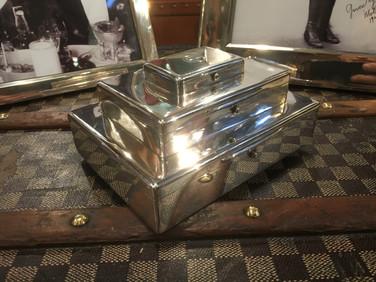 An Asprey triple tier cigar, cigarette and vesta box.