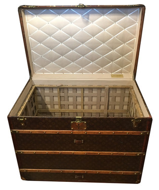 A Louis Vuitton tall courier trunk