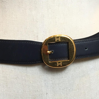 "Blue with circle ""H"" buckle"