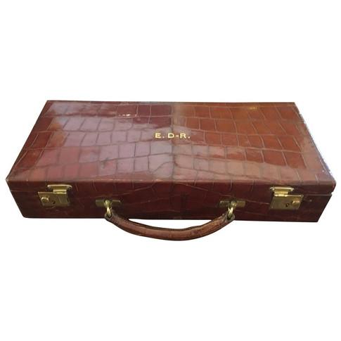An Asprey crocodile skin cantilever jewellery case