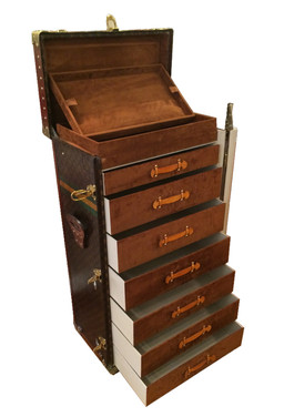 A Louis Vuitton tall trunk with drawers