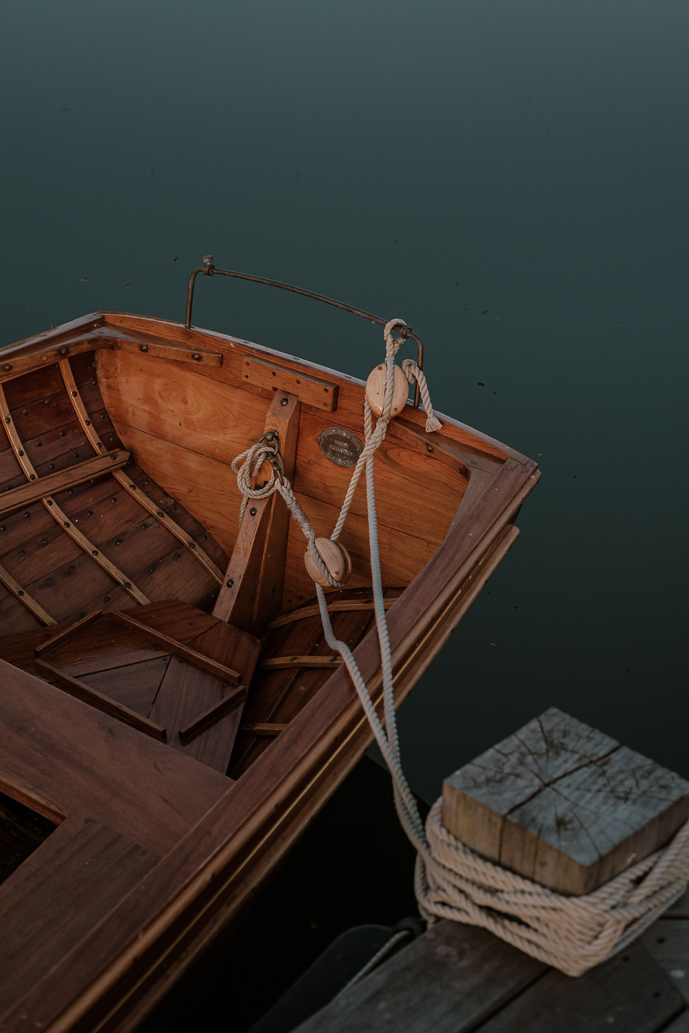 A wooden boat in a lake during summer