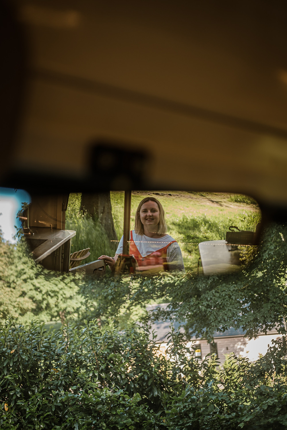 Hannah Isted Marketing in the rearview mirror of a van