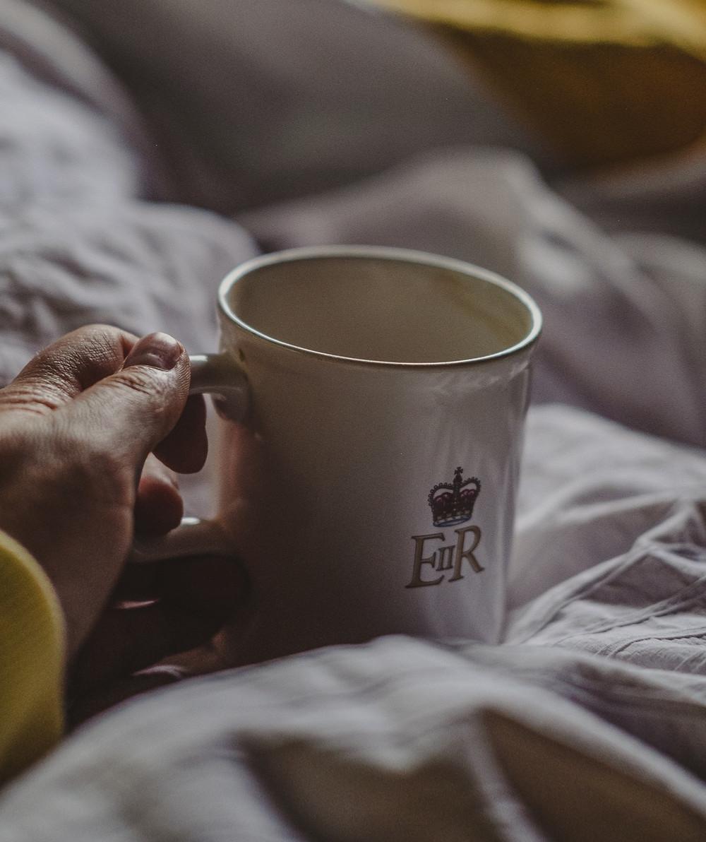 Cosy vintage cup of tea in bed