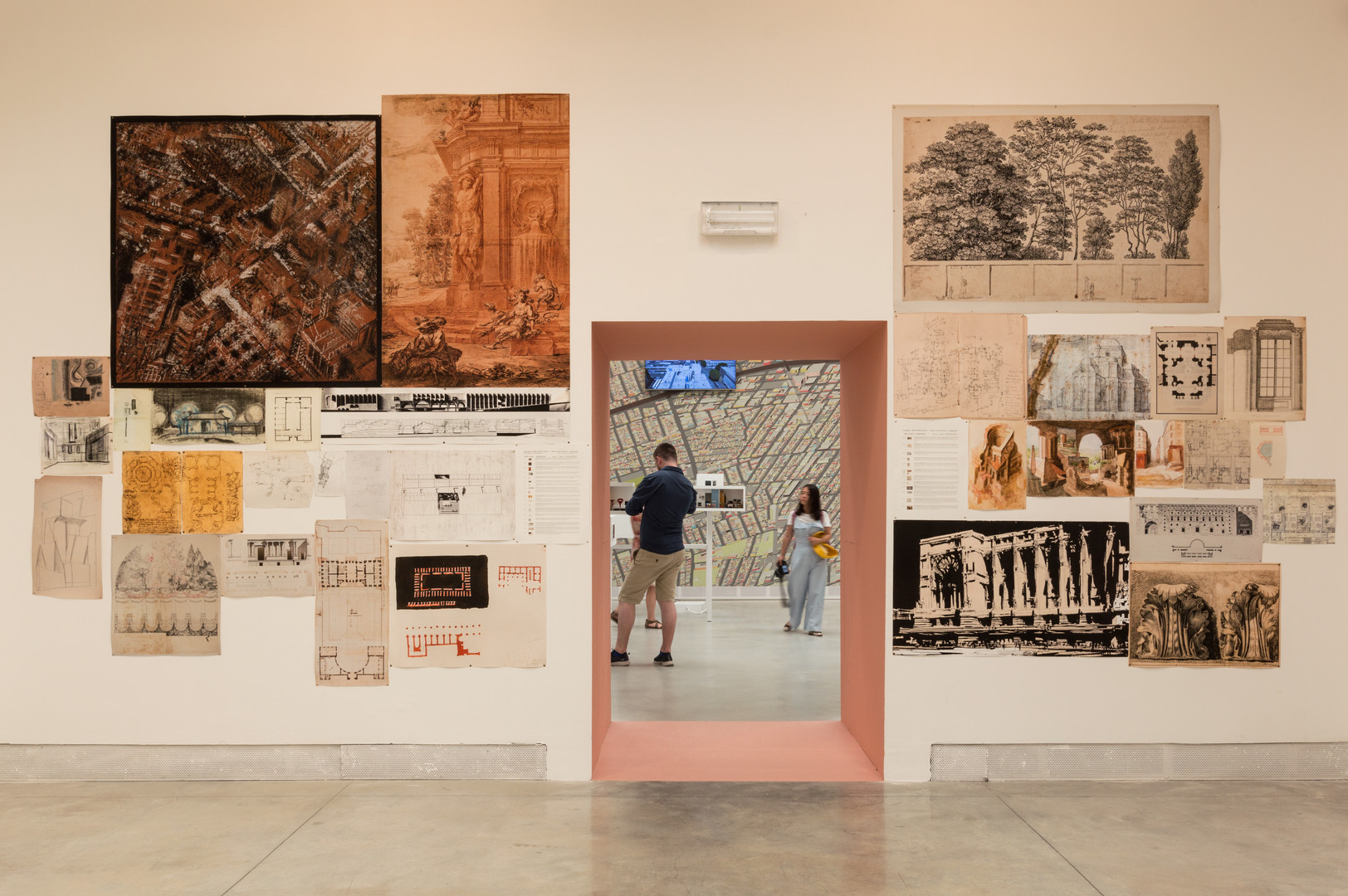Architectural Drawings on a wall curated by Elizabeth Hatz Architects at the Venice Biennale 2018