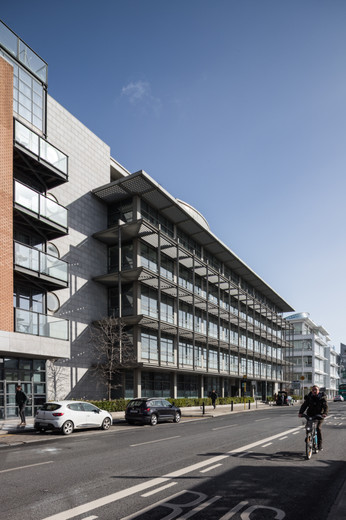 External view of granite clad and glazed facade of A&L Goodbody Headquarters in Dublin from North Wall Quay