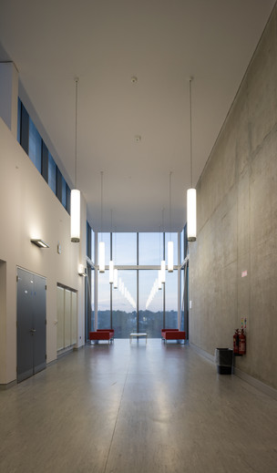 Upper floor corridor with bare concrete finish of main campus development of St.Pats, DCU campus, Dublin