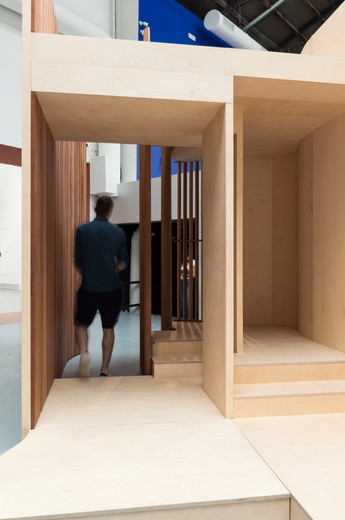 Man walks through timber pavilion, El Girasol, designed by GKMP Architects at the Venice Biennale 2018
