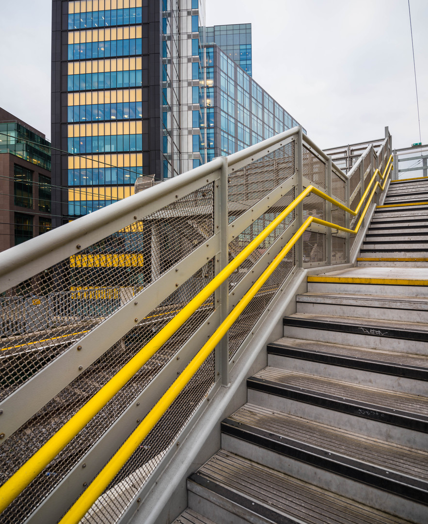 Stairs to pedestrain bridge connecting track to Montevetro in Dublin