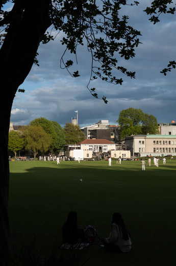 View across the cricket pitch of the Pavilion in Trinity College, Dublin