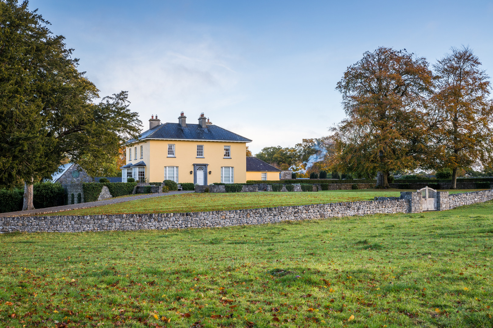 View across field with stone wall of Hollywood House, Limerick