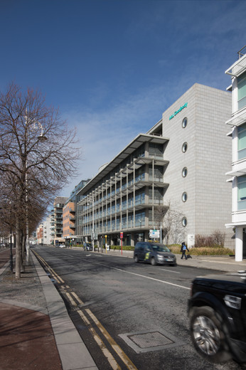 External view of granite clad facade of A&L Goodbody Headquarters in Dublin from North Wall Quay