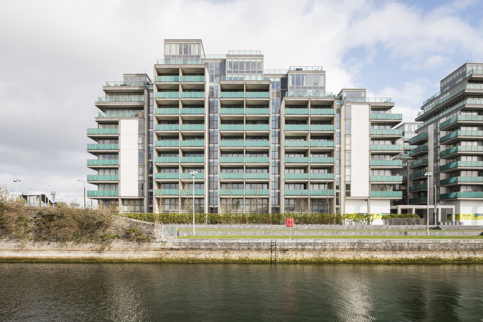 External view of the Spencer Dock Apartments in Dublin from Linear Park