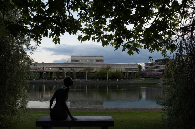 Framed view of statue of woman on bench of the Library at UCD, Dublin