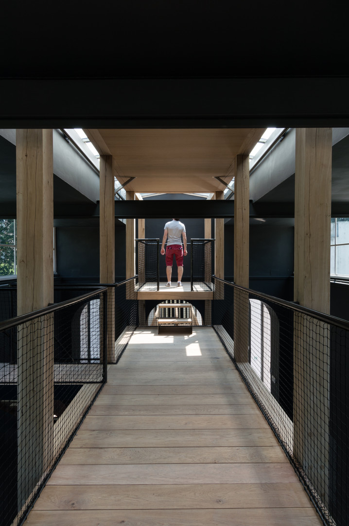 Person standing at platform at end of timber bridge at Austria's pavilion at the Venice Biennale 2018