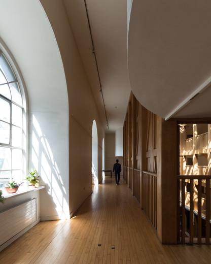 Upper corridor of the oak clad Atrium in Trinity College Dublin,
