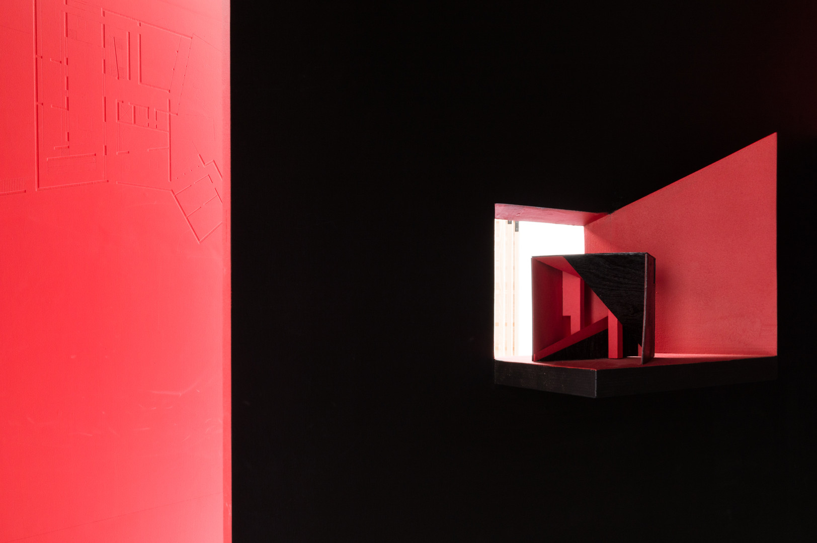 A model inside the black and red pavilion designed by A2 Architects at the Venice Biennale 2018