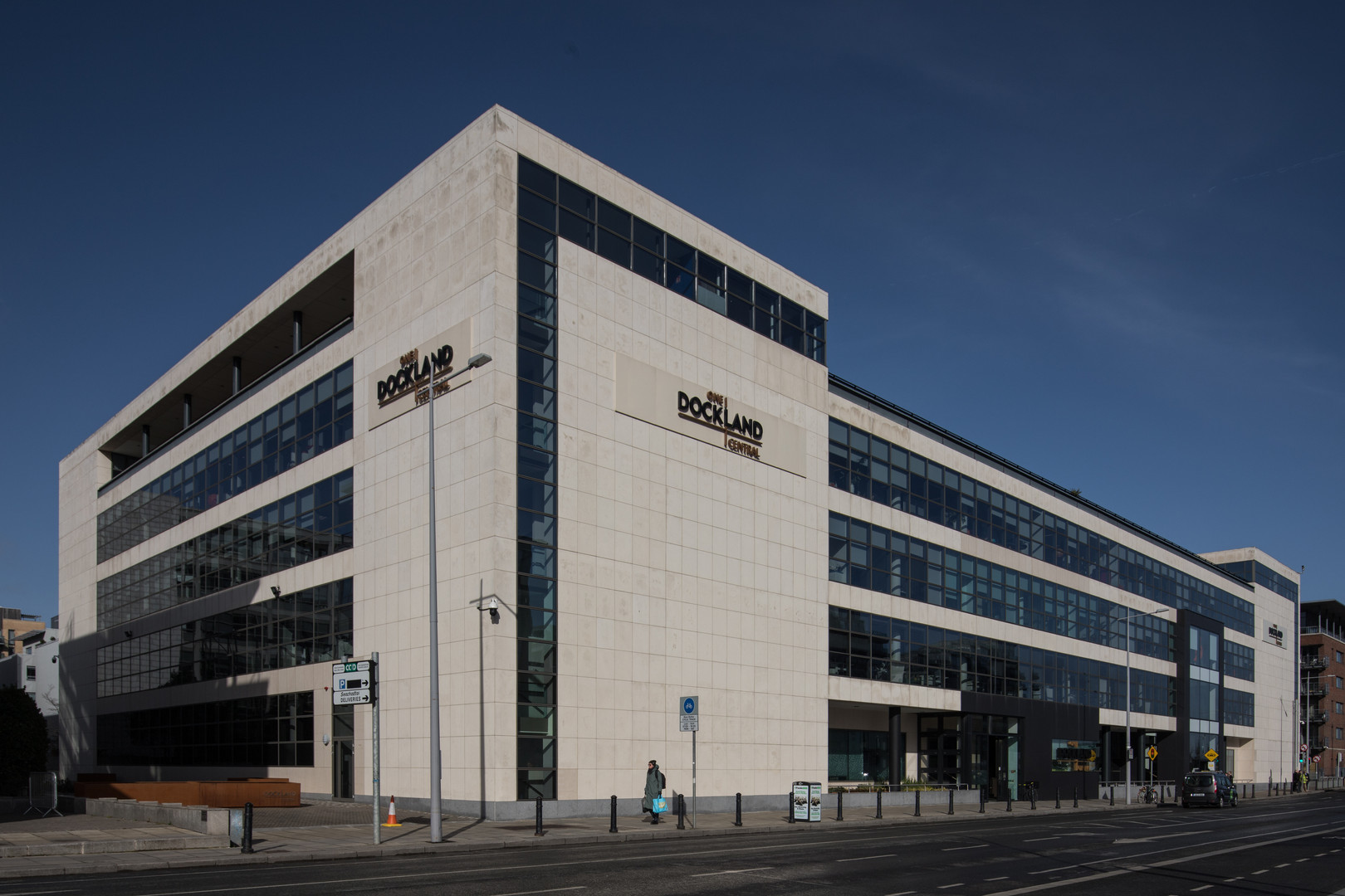 External view of Portuguese limestone clad facade of the Guild House IFSC in Dublin from Guild Street