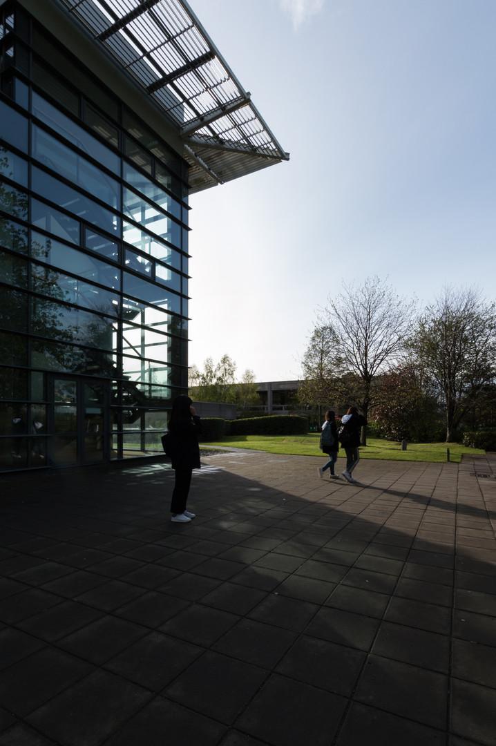 Exterior of Quinn School of Business in UCD, Dublin, casting long shadows