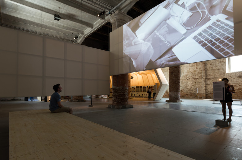 Person watching screen of Sergison Bates Architects pavilion at the Venice Biennale 2018