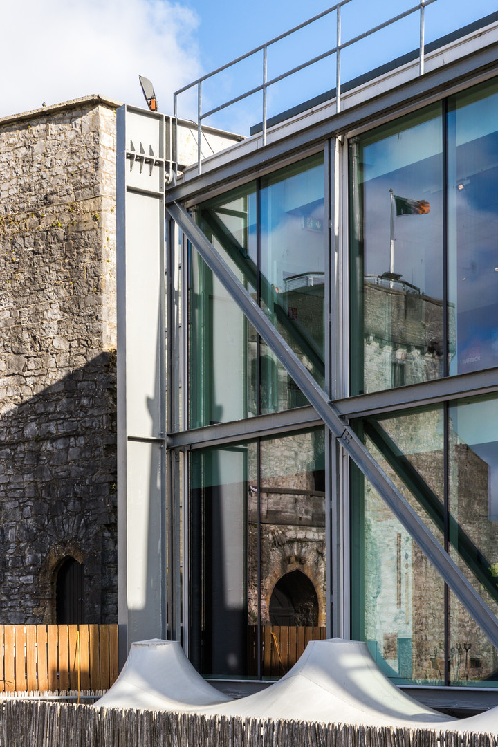 Detail of glazed facade and steel structure and stone wall of King John's Castle, Limerick