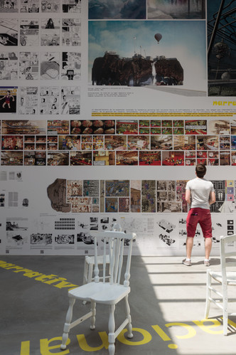 Person examining walls of the interior of Spanish pavilion at the Venice Biennale 2018