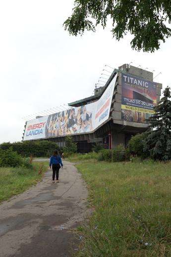 The Forum Hotel (FORUM Przestrzenie) covered in a large advertisement in Krakow.