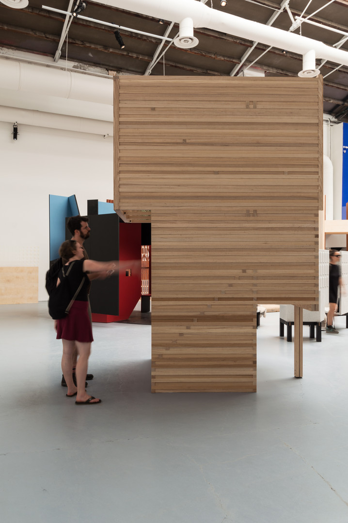 People looking at a timber pavilion designed by Steve Larkin Architects at the Venice Biennale 2018