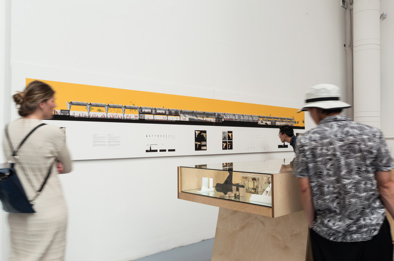 People looking at drawings and models of Anhembi Tennis Club exhibition by Donaghy + Dimond at the Venice Biennale 2018