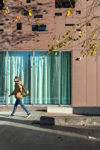 Person walking by Library of St.Pats, DCU campus, Dublin