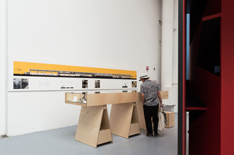 Man looking atAnhembi Tennis Club exhibition designed by Donaghy + Dimond at the Venice Biennale 2018