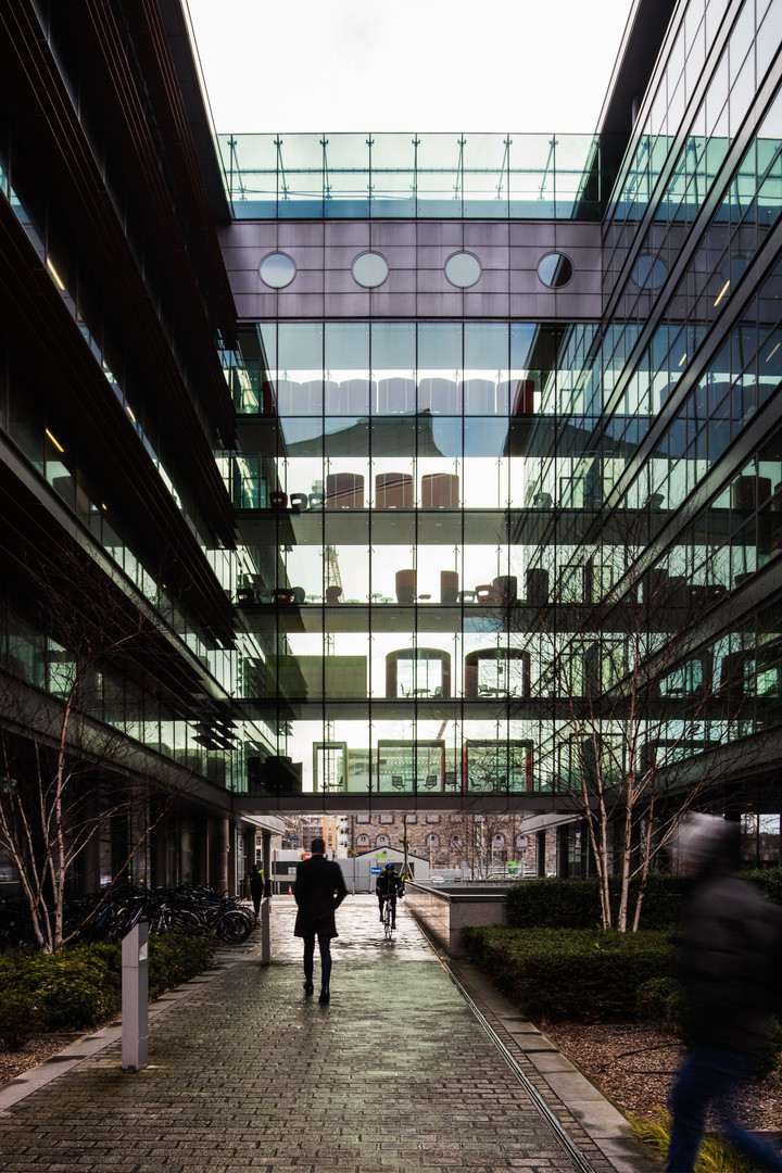 External view of the glazed corridor of the Spencer Dock PWC office building in Dublin