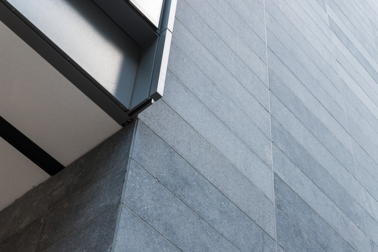 Detail of aluminum fins and stone cladding of 4-5 Harcourt Road