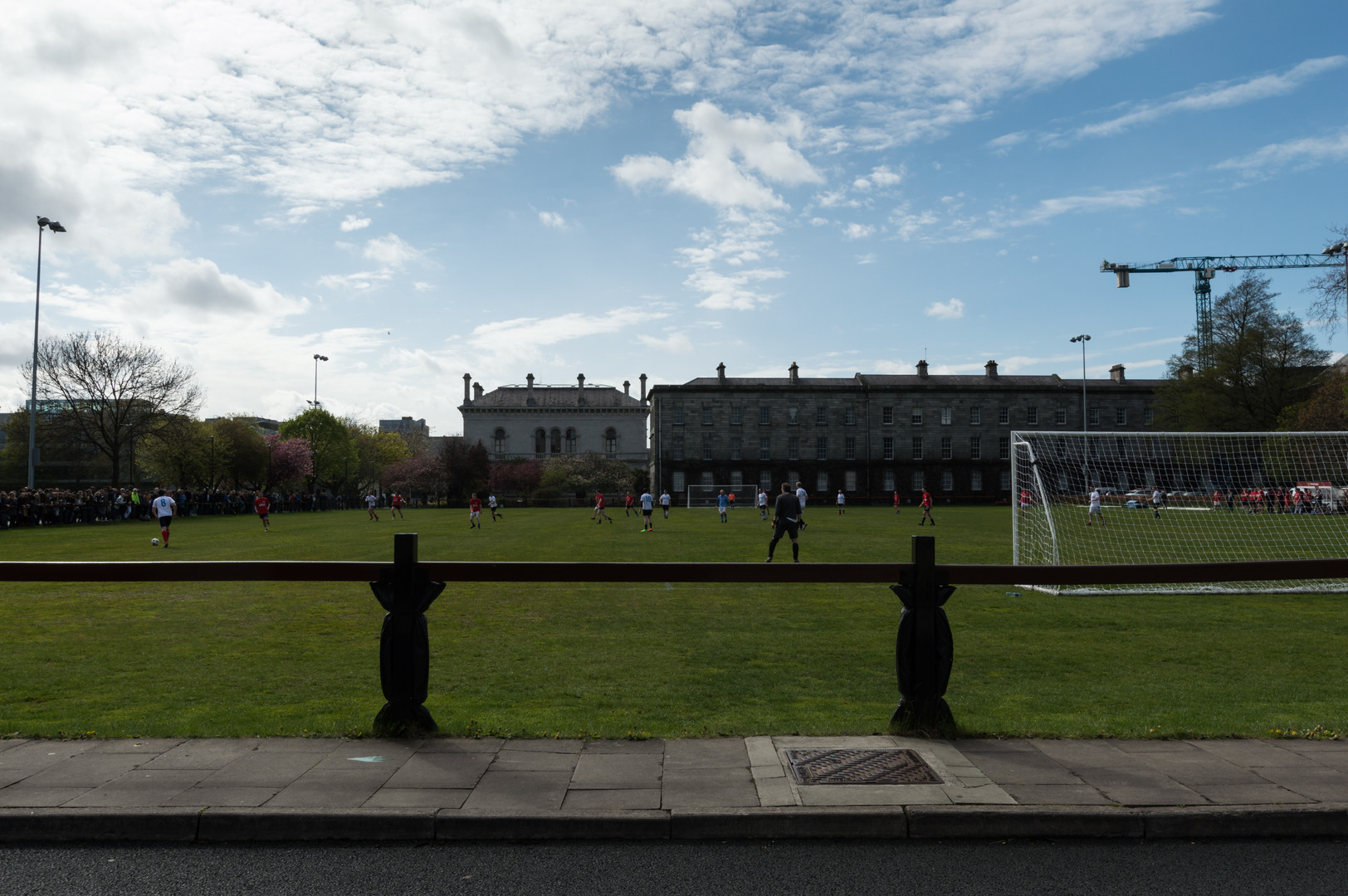 A game of soccer taking place on a pitch at Trintiy College, Dublin