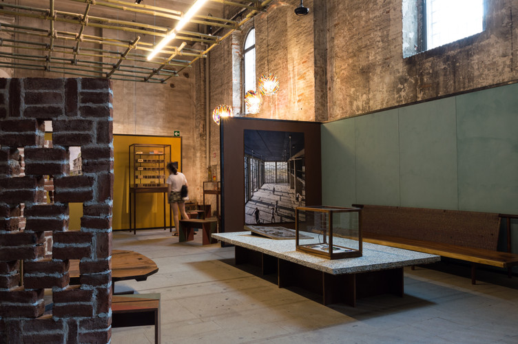 Photos, models and furniture on display at the pavilion designed by Case Design at the Venice Biennale 2018