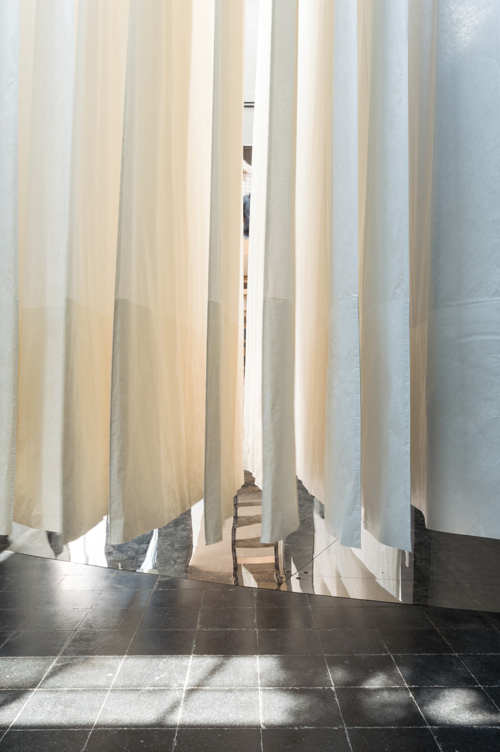 White curtain hanging over black tiled floor of the Austrain pavilion at the Venice Biennale 2018