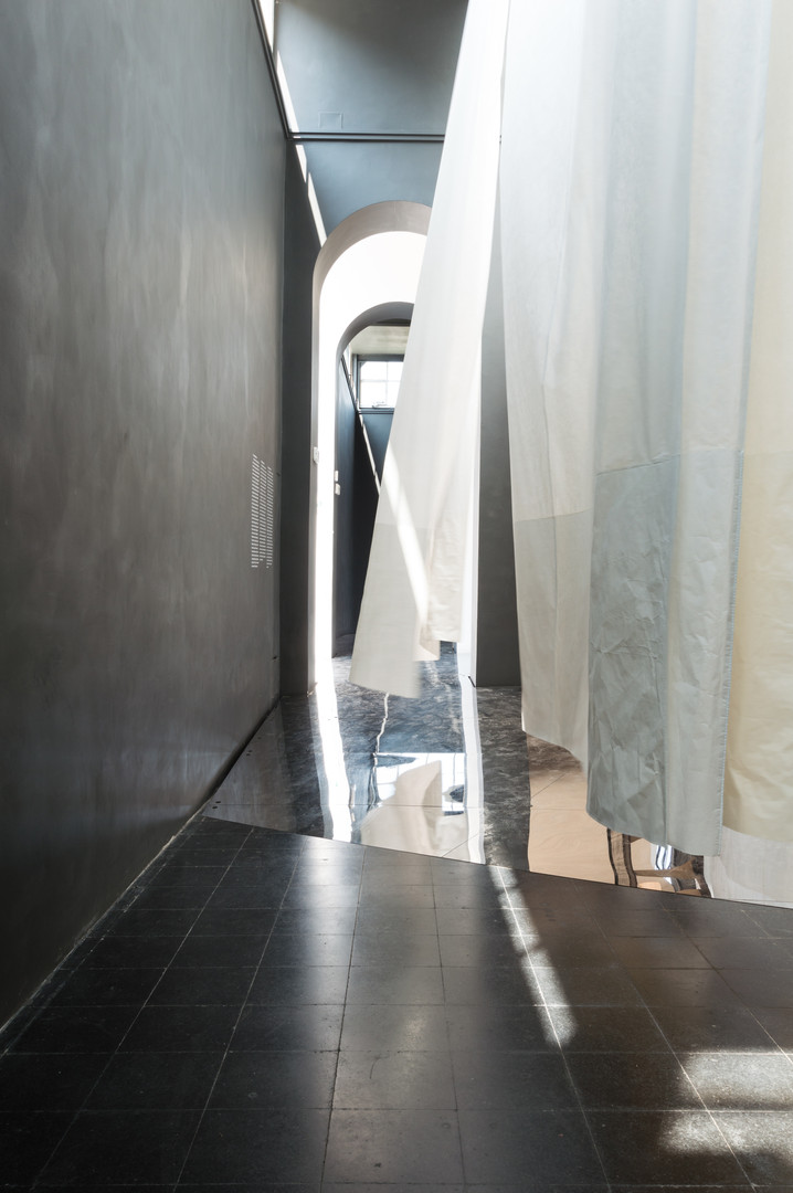 White curtain blowing over black tiled floor in the Austrain pavilion at the Venice Biennale 2018