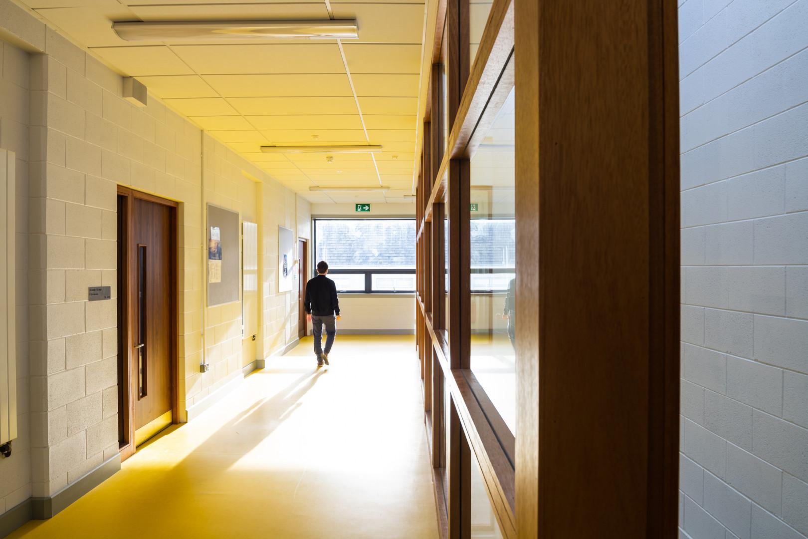 Internal corridor with yellow linoleum floor of Colaiste Iosaef, Kilmallock, Limerick