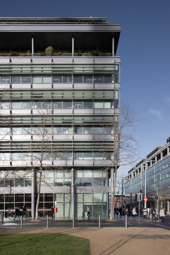 External view of the Spencer Dock PWC office building in Dublin from Linear Park