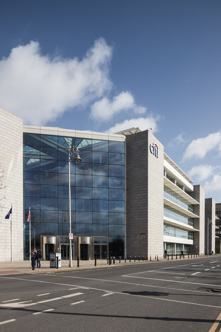 External view of granite clad and glazed facade of Citibank in Dublin from North Wall Quay